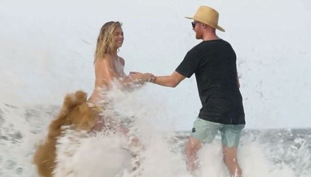Wave pulls bro move, gives Sports Illustrated worker a face full of Kate Upton'sBoobs